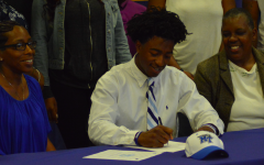 OHS football players sign National Letter of Intent