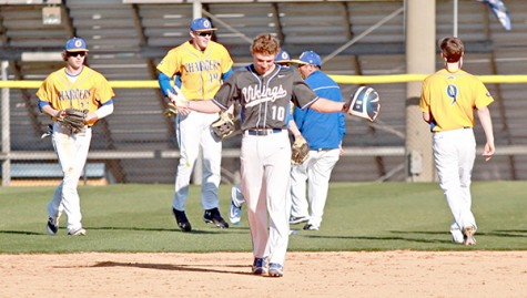 Warren Central's Brooks Boolos (10) shrugs his shoulders as Oxford's players celebrate behind him Friday. Boolos was robbed of the game-tying hit by Oxford right fielder Houston Roth for the game's final out, and Oxford escaped with a 3-2 victory. (Ernest Bowker/The Vicksburg Post)