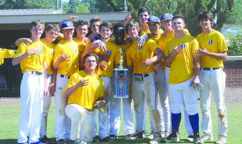 The OHS baseball team poses for a picture after winning the NEMCABB tournament.