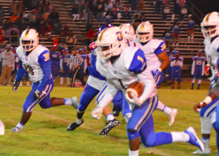 Hiram Wadlington breaks loose for a big run. Wadlington finished with 120 rushing yards