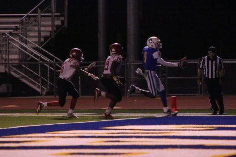 Junior wide receiver Jaquan Webb scores a touchdown against Center Hill. Webb finished with two touchdowns receiving.
