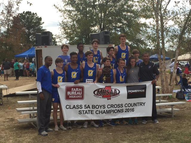 The OHS boys cross country team poses for a picture after winning the MHSAA Class 5A State Championship.