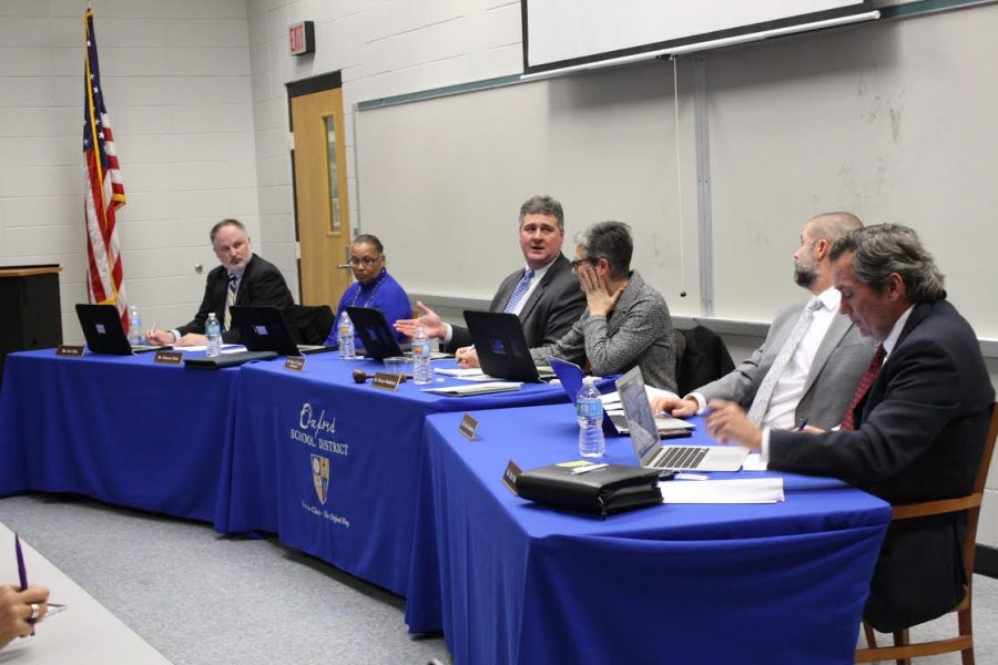 Superintendent Brian Harvey speaks to the school board on Jan. 23 about the impact the EdBuild formula could have on the Oxford School District.