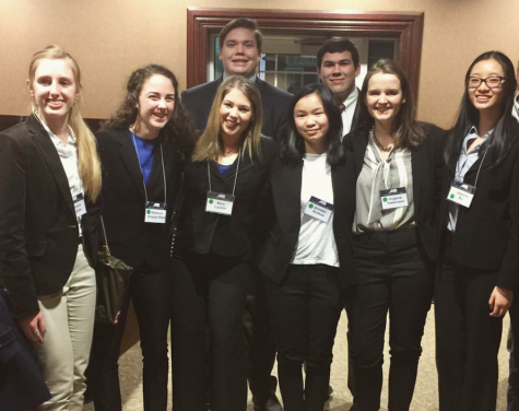 Left to right: junior Ann Sullivan, senior Rebecca Grayzel-Ward, senior Reed Cooper, senior Mary Lauren Green, sophomore Anneke Buskes, junior Josh Pearson, senior Virginia Parkinson, and junior Joanna Bu gather for a picture after competing at the Mock Trial regional competition on Jan. 28, where they went undefeated.