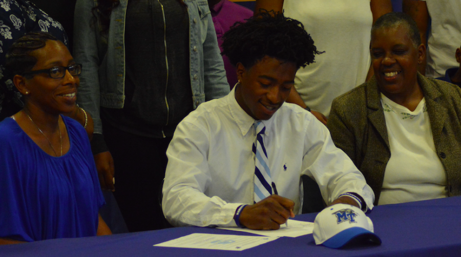 Senior D.Q. Thomas signs his National Letter of Intent to play football for MTSU next season.