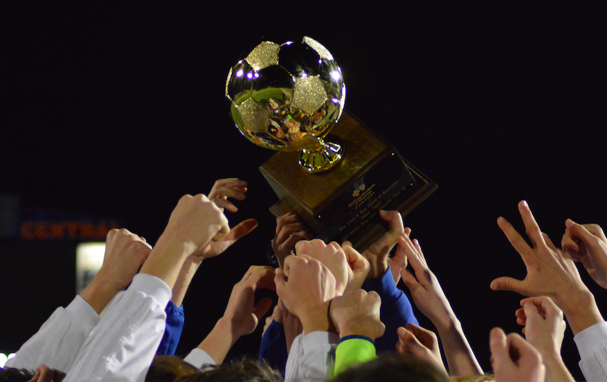 The OHS boys soccer team hoists the golden ball after defeating West Jones.