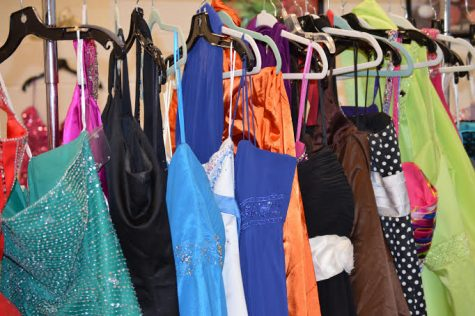 Dresses donated by members of the Oxford community hang at the