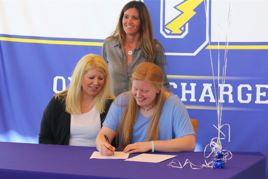 Senior Maggee Hobson signs her national letter of intent. She was one of two student athletes to sign that day.
