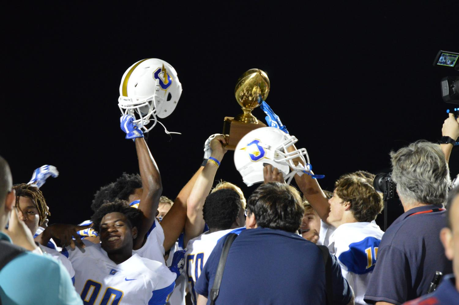 The Chargers hoist the Crosstown Classic Trophy following the Oxford's 41-17 win over Lafayette.