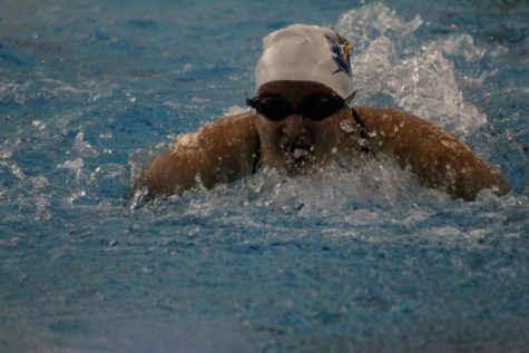 Junior Noël Torma competes during the swim meet in Tupelo. The Chargers finished second behind Tupelo.