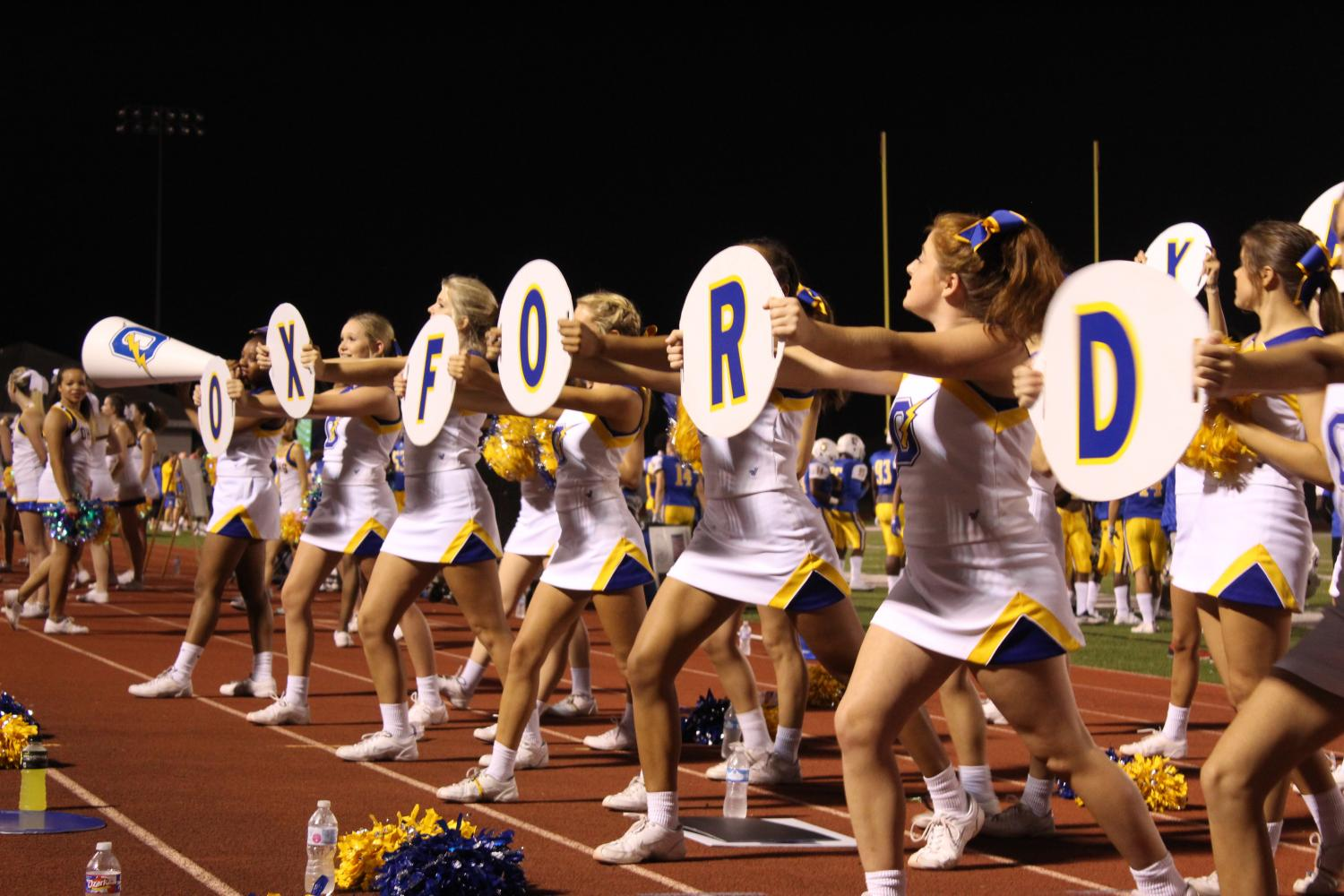Cheerleaders on the varsity team cheer on the Chargers at their game against Pontotoc.