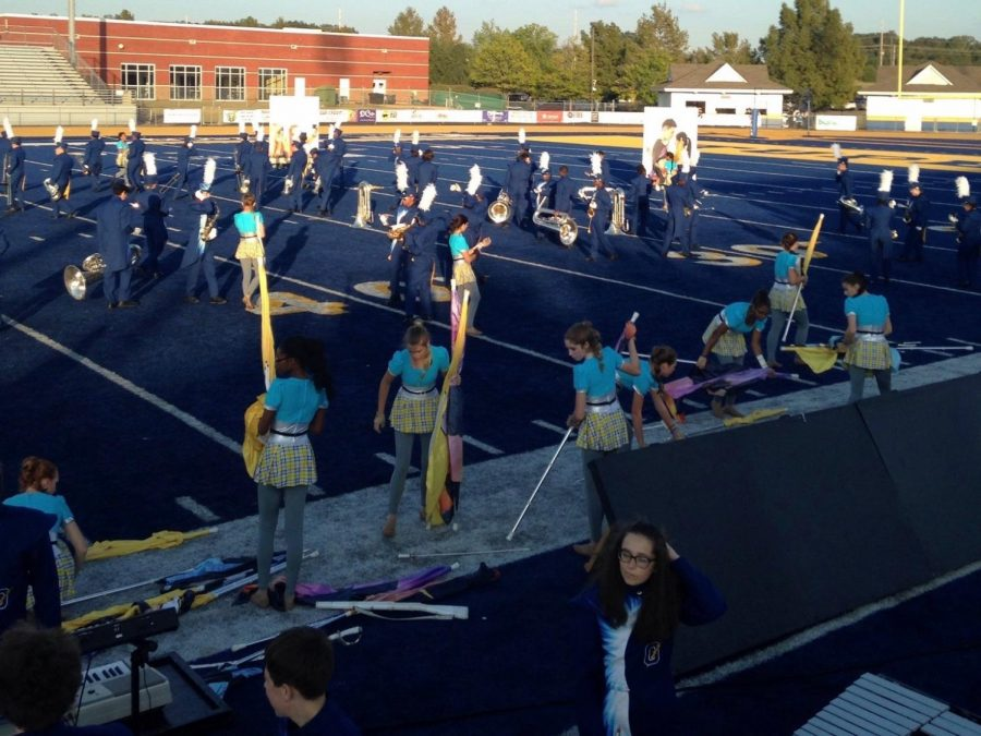 Band+and+color+guard+members+take+the+field+Oct.+14+at+the+regional+competition.