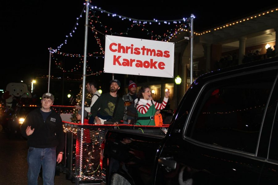 The Orchard Church's karaoke float passes by everyone watching the parade. Their float was covered in Christmas lights, and they performed different Christmas themed songs.