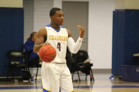 Boys basketball team remains undefeated, gains last minute win against Ashland
