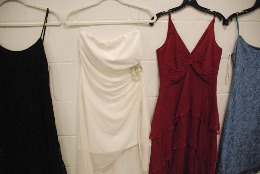 Dresses were hung around the girl's fitness room for students to pick from during the dress event for Winter Formal. The event was held on Jan. 22 and continued during Power Hour Jan. 23.