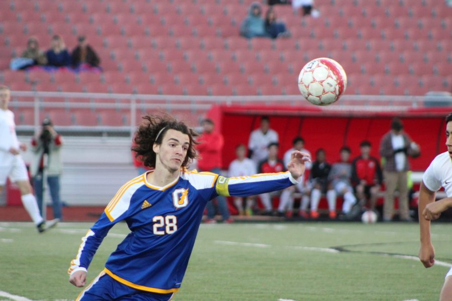 Senior+Keaton+Calhoon+goes+for+the+ball+during+the+teams+game+against+Lafayette.+He+broke+the+season+scoring+record+which+was+previously+26+goals+during+the+game+against+Tupelo.