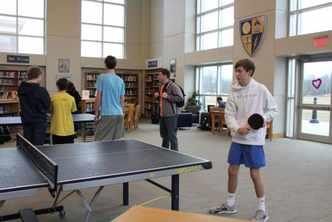 "Sophomore Ben Peeler competes in the ""I Heart Ping-Pong Tournament"". He and many other students participated in the tournament on Valentine"