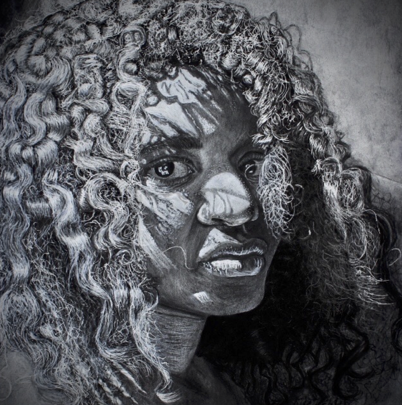 Junior Khyan Freelon won a gold key in a national competition with his drawing I TOO Am America. This photo will be exhibited in Carnegie Hall along with other gold key winners across the country.