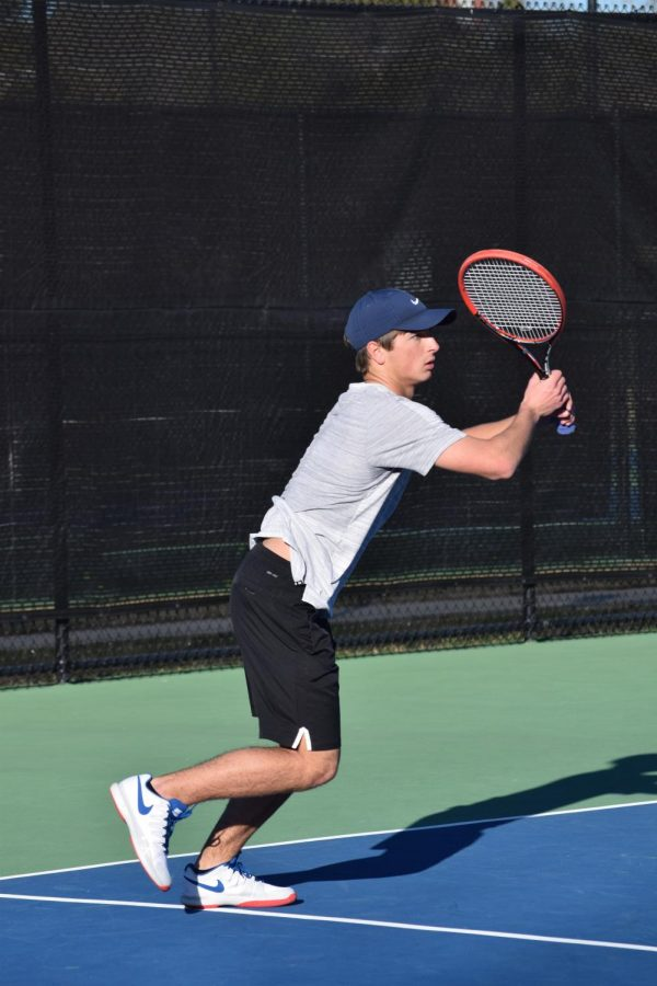 Senior Ryan Mounce serves up a ball during practice at the John Leslie Tennis Courts.