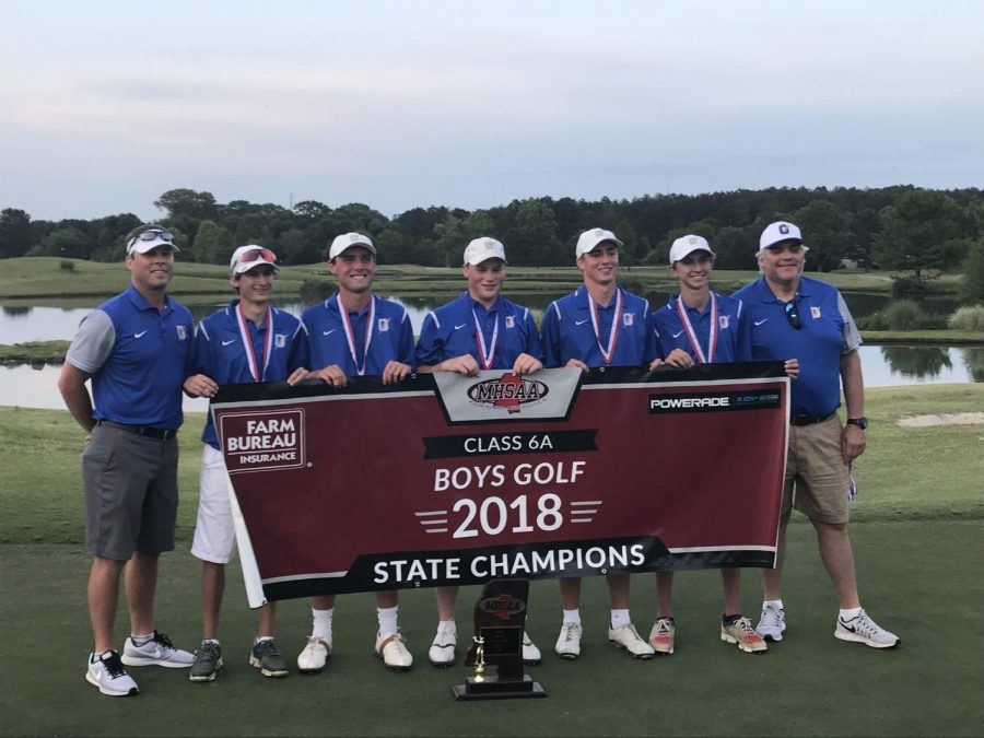The Oxford golf team and coaches pose for a picture after winning the 2018 6A Golf state championship. The Chargers took the trophy, winning by 14 strokes.