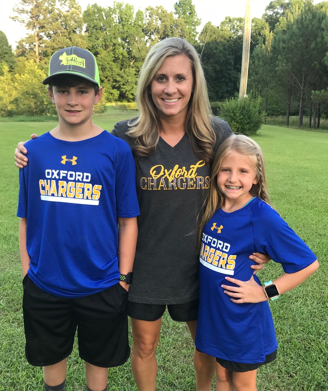 Amanda Gulledge poses with her kids, Fisher and Emory. Gulledge is new to the school district this year, and she and her children commute from Bruce, Mississippi each morning.