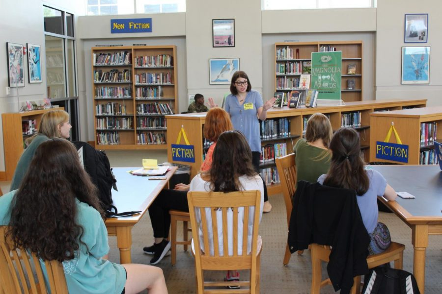 Sami Thomason talks to the members of the book club during their first meeting. Thomason has returned to OHS to revive the book club that she was a part of when she was an OHS student.