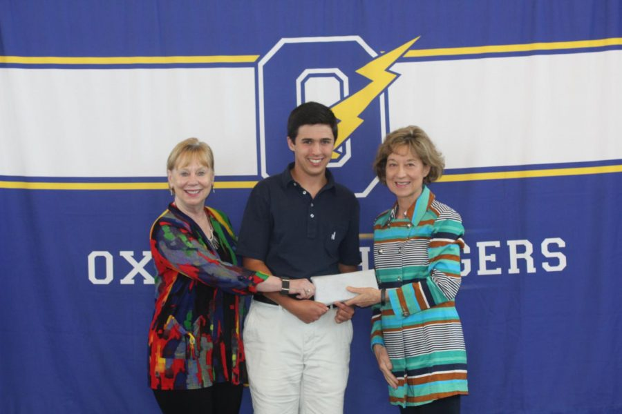 Jack Ligon presents the check to Mary Harrington and Dr. Jo Ann O'Quin from Memory Makers on Sept. 11. Ligon hosted the second annual tennis tournament to raise money for Memory Makers.