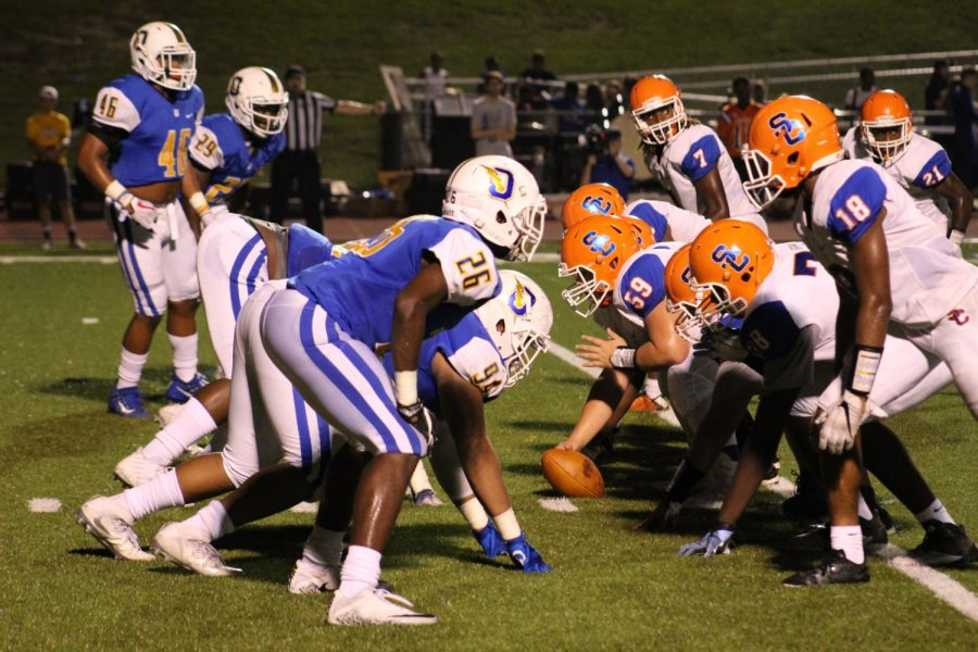 The+Oxford+Chargers+defense+lines+up+against+the+Southaven+Chargers+offense+during+last+years+meet-up.+The+South+Chargers+beat+the+Oxford+Chargers+last+year+with+a+score+of+23-13.