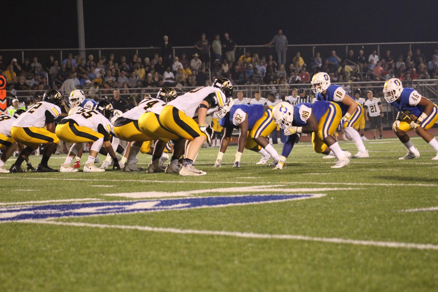 During last year's game against Pontotoc, the Chargers offensive line lines up. The Chargers finished the regular season with a 33-13 win over Tupelo last week.