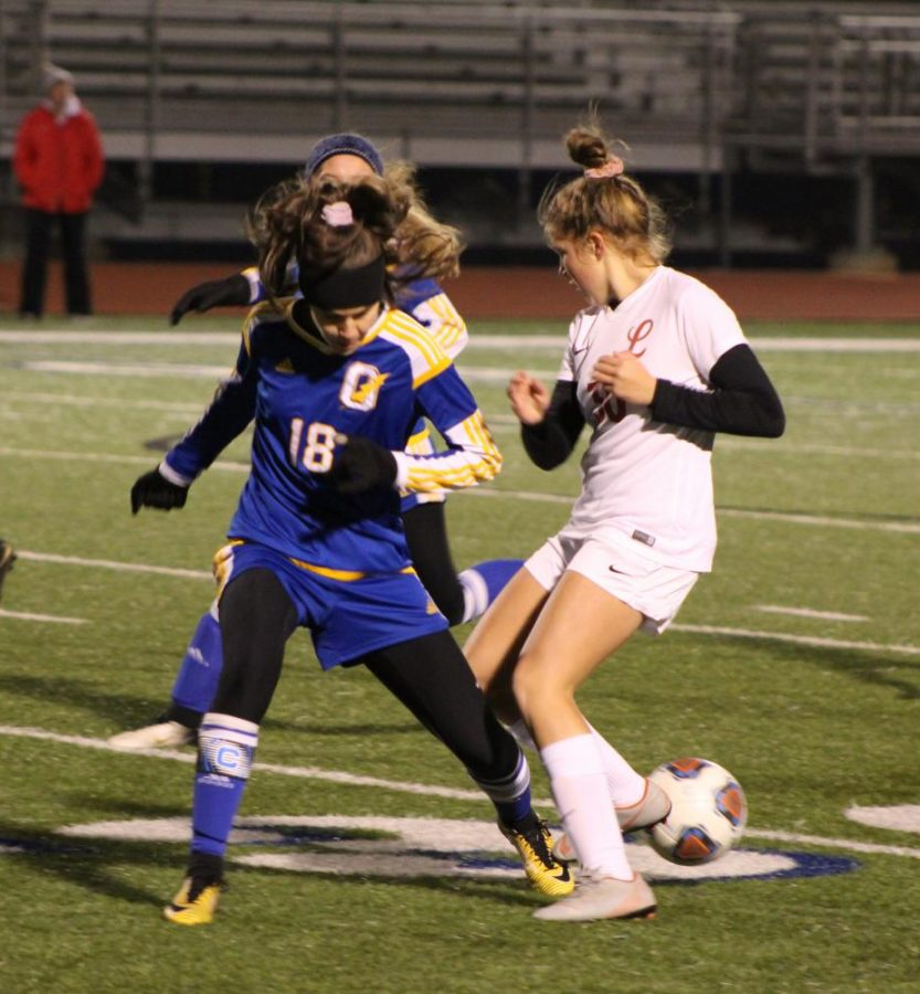 Senior Addie Thompson defends the ball against a Lafayette Commodores player earlier this season. The Chargers game against Clinton was also senior night for the girls team, where seven seniors were honored.