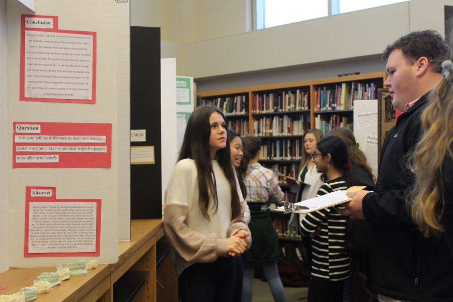 Freshman+Ember+Reysen+presents+her+science+fair+project+to+one+of+the+judges.+The+science+fair+took+place+on+Jan.+23%2C+and+it+allowed+students+to+better+their+public+speaking+skills+while+learning+new+things+about+their+topics.