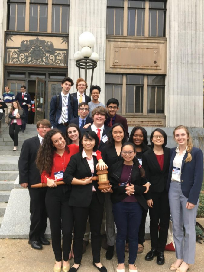 Members+of+the+Mock+trial+team+stand+and+smile+with+their+awards+from+the+state+competition.+The+team+placed+fourth+at+the+state+competition+on+.+