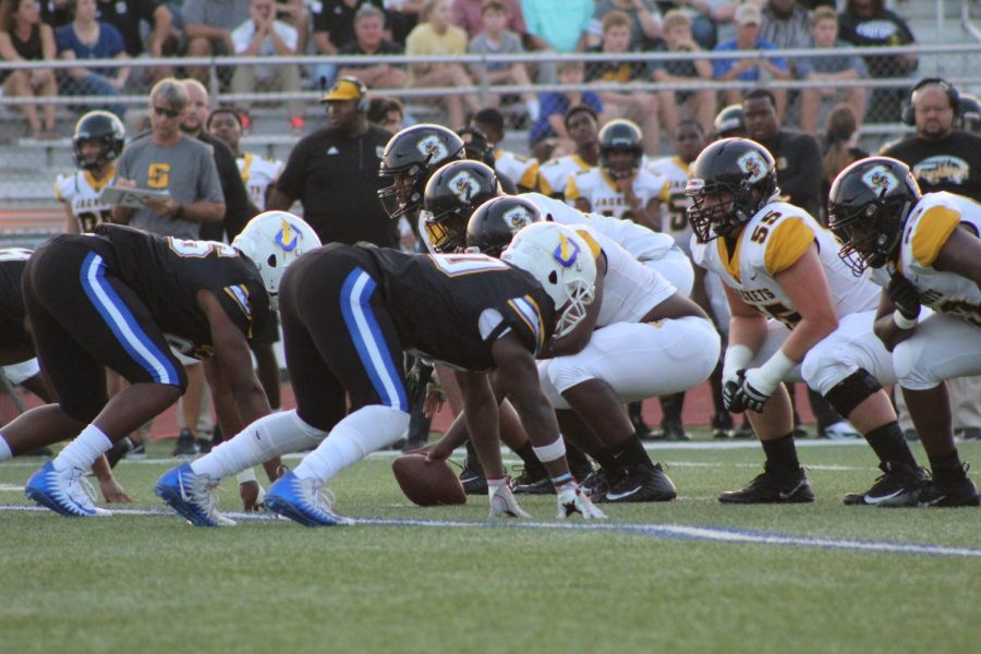Senior defensive end Jeremiah Pomerlee lines up against Starkville's offensive line in last year's Little Egg Bowl. The Yellowjackets defeated the Chargers by a score of 56-7