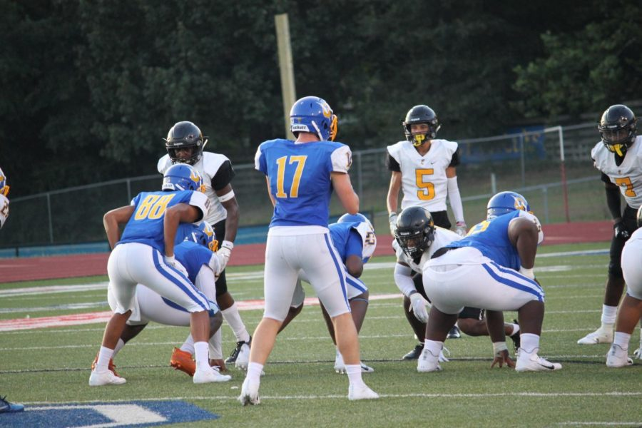 Senior quarterback John Meagher prepares to receive the snap in the fall jamboree. As a junior, Meagher threw for 1,575 yards and 14 touchdowns in addition to 536 yards and nine touchdowns rushing.