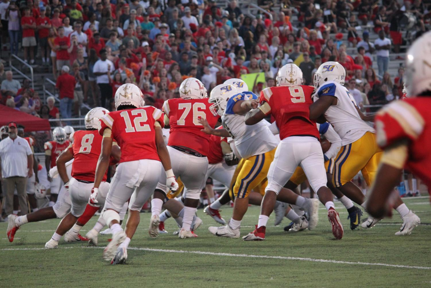 The Oxford offensive line battles against the Lafayette Commodore defensive line earlier in the season against Lafayette. Oxford won the game 46-7.