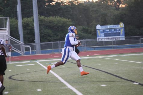 Senior JJ Pegues runs for a touchdown in this season