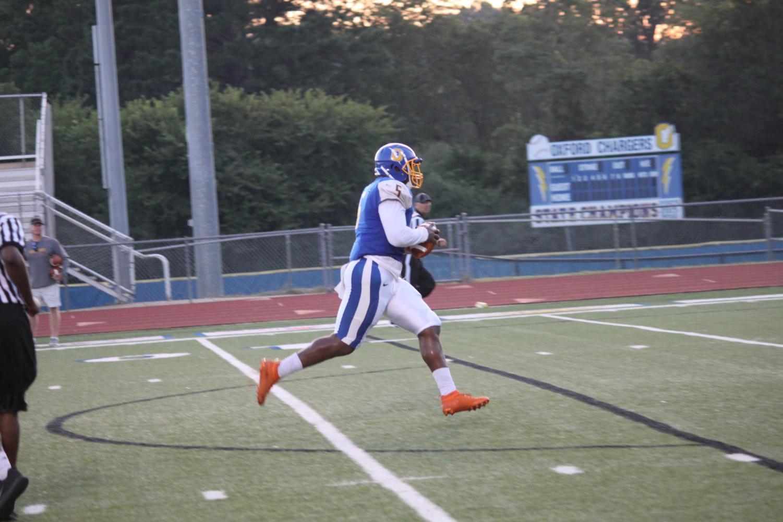 Senior JJ Pegues runs for a touchdown in this season's jamboree against Charleston. Pegues has nine total touchdowns in his senior campaign.
