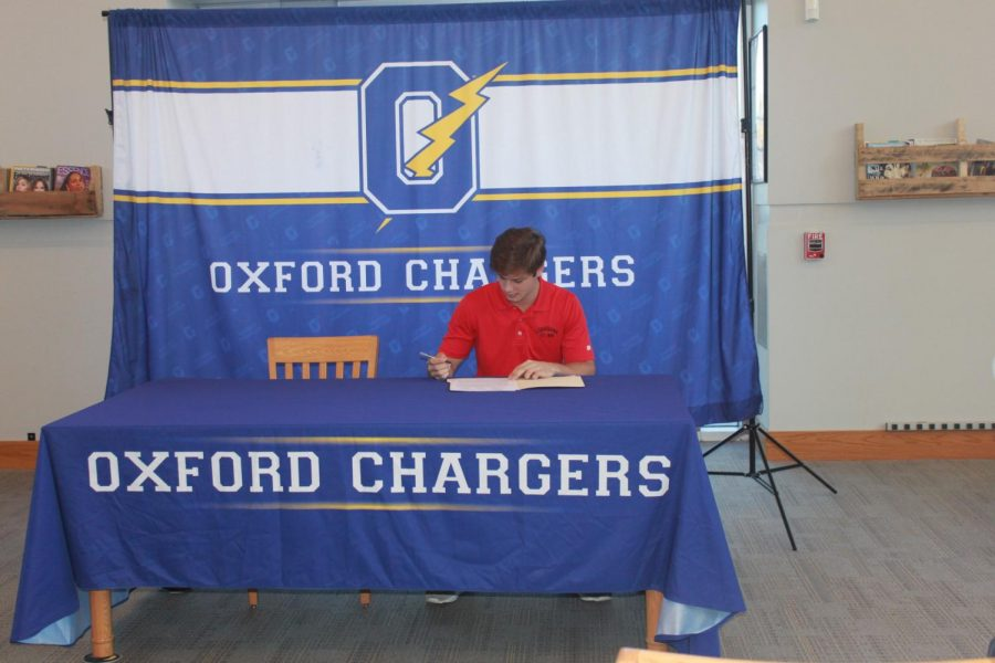 Senior+Sam+Bianco+signs+his+commit+to+Louisiana-Lafayette+on+College+Signing+Day.+Bianco+is+currently+a+member+of+the+OHS+Baseball+Team.+