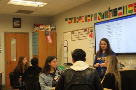 Junior Paula Garcia Serrano and seniors Addison Murphey and Seth Meintasis talk to French teacher Chelsea Winnick in French during French Conversational Group. The conversational group was put together to help students practice and become more comfortable speaking French.