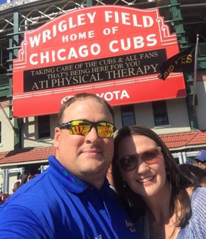 History teacher Daniel Parrish and his wife Lana Parrish smile in front of Wrigley Field. Daniel Parrish teaches history and coaches baseball for OHS.