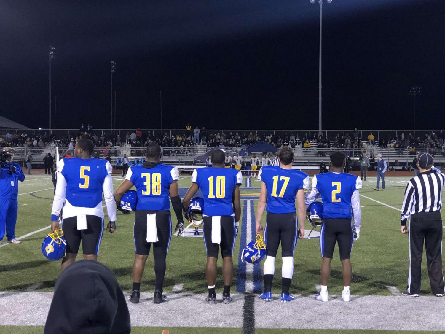 Seniors JJ Pegues, Kiyon Williams, Dude Person, John Meagher and Javian Gipson-Holmes line up before the coin toss for their game against Starkville. The Chargers won the game 25-16 and will play the Oak Grove Warriors in the 6A State Championship.