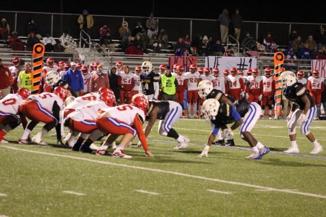 The Chargers' defense lines up against the Warren Central Vikings. The Chargers traveled to Hattiesburg to play in their first 6A Championship game.