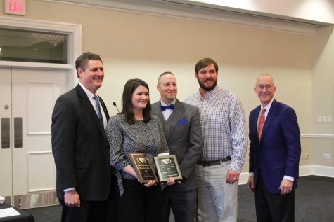 Superintendent Brian Harvey, OHS Biology teacher Sarah Robinson, OHS Principal Noah Hamilton, Cory Franks, and David Brevard, the CEO of B and B Concrete, smile with Robinson's awards. Robinson was awarded OHS and OSD Teacher of the Year at a new luncheon held by Oxford community members and donors.