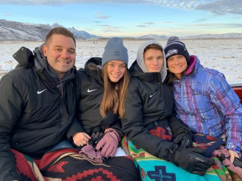 Sophomore Grace, Tatum, Brad and senior Luke Freeman pose for a family picture in Wyoming during the holidays. The Freeman family has a history of participating in Oxford sports programs.