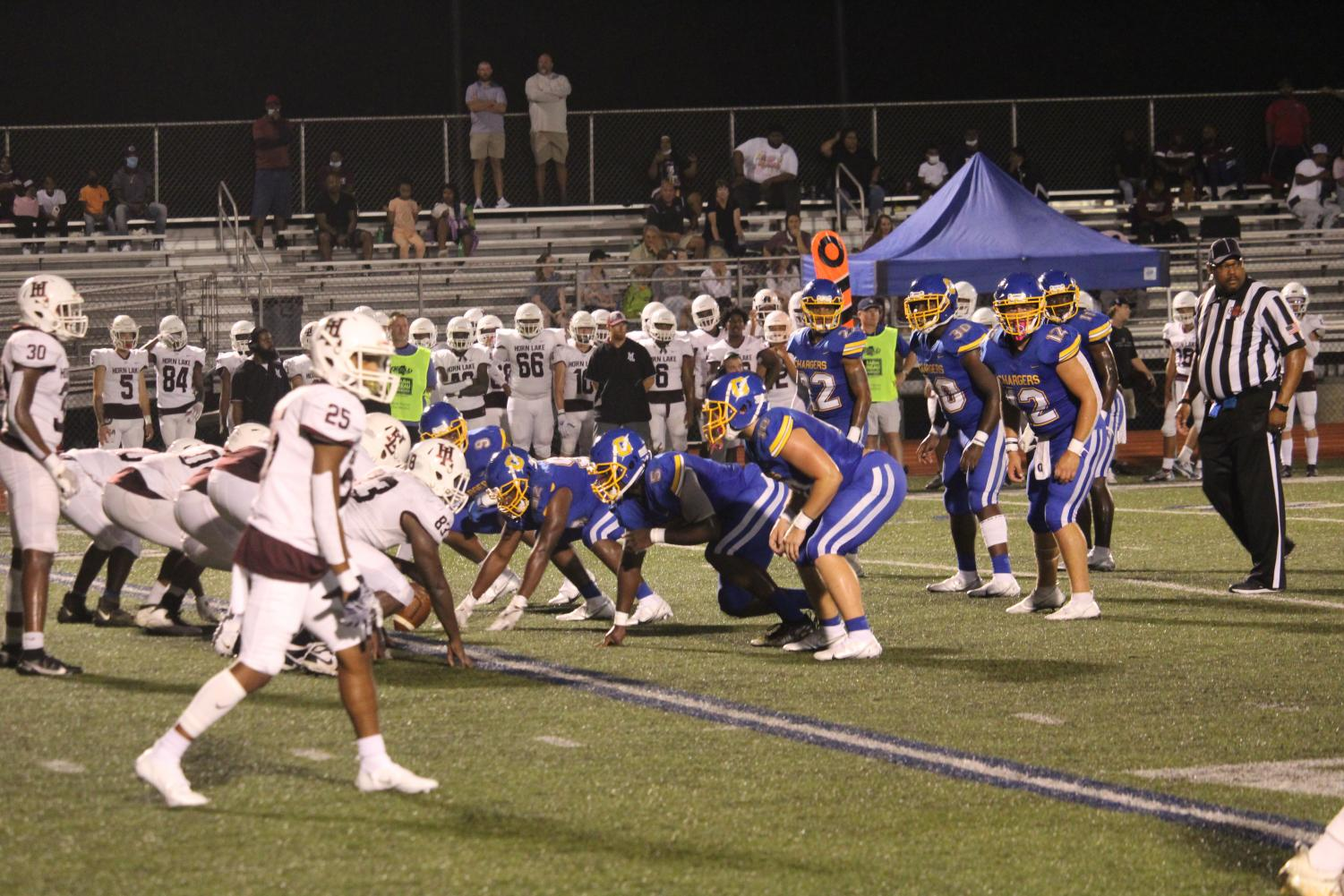 The Charger defense lines up during a play at the jamboree game against Horn Lake on Friday, August 20.