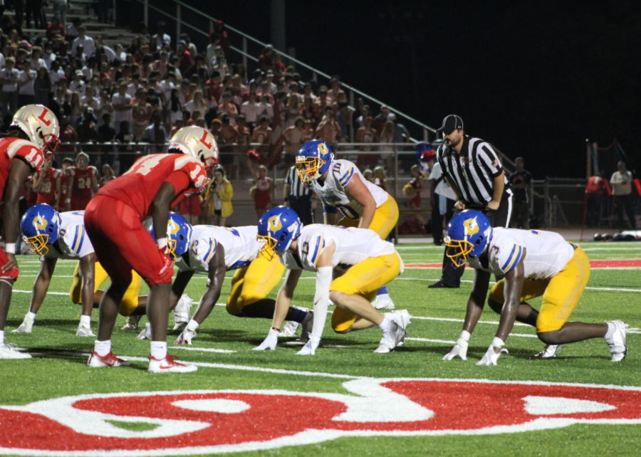 The Chargers prepare for a play against the Lafayette High School Commodores on September 17. The Chargers lost the game 32-23.